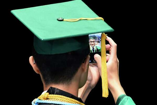 Valedictorian Chen Qu completes a selfie from his position at the podium on the stage before his address at the Shenendehowa High School Commencement Thursday at the Saratoga Performing Arts Center June 23 2016 in Saratoga Springs, N.Y. (Skip Dickstein/Times Union)