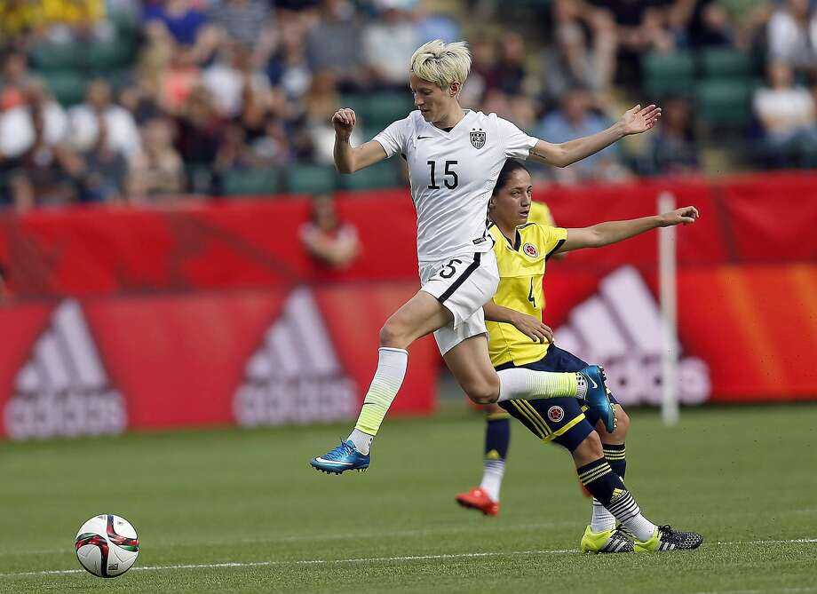 Megan Rapinoe vies for the ball during the Round of 16 match at the 2015 FIFA Women's World Cup on June 22, 2015, in Edmonton, Canada. Photo: Qin Lang, McClatchy-Tribune News Service