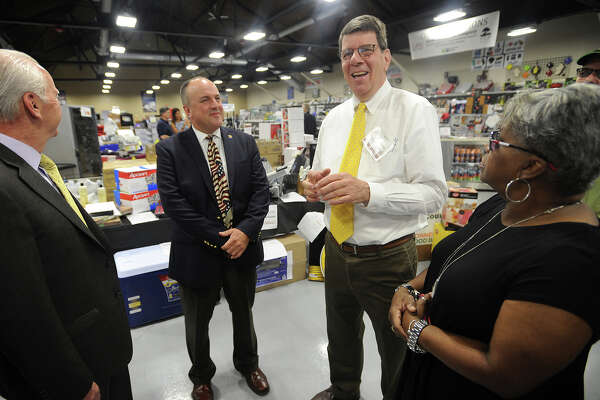 President Jay Ringelheim, second from right, gives a tour of Globe Equipment Company's new showroom during the business' grand re-opening at 300 Dewey Street in Bridgeport, Conn. on Thursday, June 23, 2016. From left are Edward Adams, senior adviser for the City of Bridgeport, Christopher Alarcon, constituent services specialist for the city, Ringelheim, and Bridgeport State Senator Marilyn Moore.