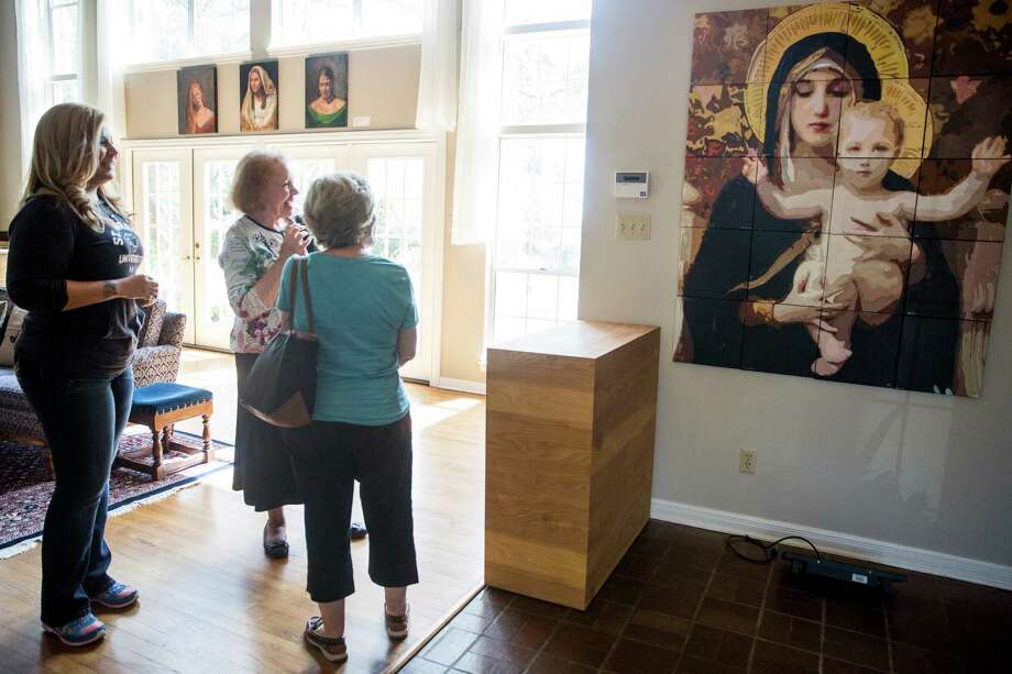 "Visitors enjoy the artwork ""Holy Mary, Mother of God,"" at St. Mary's University. It was created by St. Mary's University professor James Joffe's color theory class participants in 2015. The unversity is embarking on a major project to rebuild and add new student housing on campus. Photo: By Carolyn Van Houten / San Antonio Express-News / 2015 San Antonio Express-News"