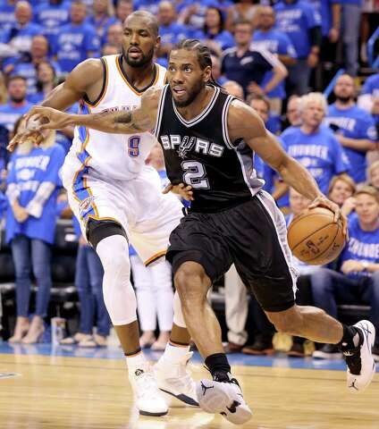 bba2f80019d9 Spurs  Kawhi Leonard drives around the Thunder s Serge Ibaka during  second-half action of