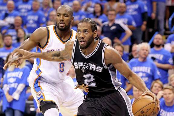 Spurs' Kawhi Leonard drives around Oklahoma City Thunder's Serge Ibaka during second half action of Game 6 in the Western Conference semifinals on May 12, 2016 at Chesapeake Energy Arena.