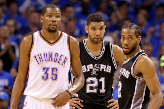 Oklahoma City Thunder's Kevin Durant, Spurs' Tim Duncan, and Kawhi Leonard pause during second-half action of Game 6 in the Western Conference semifinals on May 12, 2016 at Chesapeake Energy Arena.