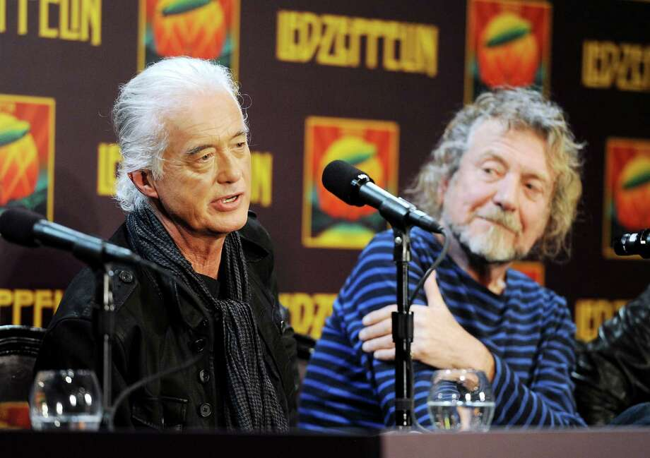 """Led Zeppelin guitarist Jimmy Page (left) and singer Robert Plant appear at a 2012 news conference. A federal court jury decided Thursday that the band did not steal a riff from an obscure 1960s instrumental tune to use for the introduction of its classic rock anthem """"Stairway to Heaven."""" Photo: Associated Press File Photo / Invision"""