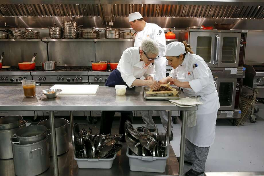 Chef instructor Catherine Pantsois works with student Gina DeMartini during class. Photo: Michael Macor, The Chronicle