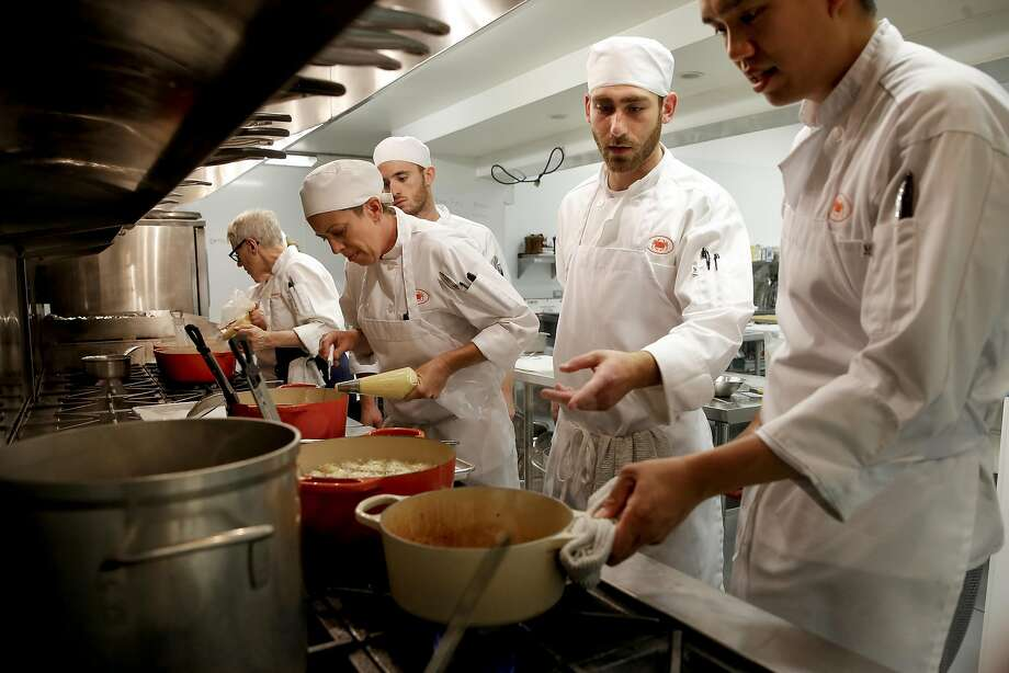 Chef-instructor Catherine Pantsois (far left, facing away) works with students Jamie Gabriel (left), Jason Lauer, Josh Liebeskind and Richard Vi as they prepare potatoes at the San Francisco Cooking School. Photo: Michael Macor, The Chronicle
