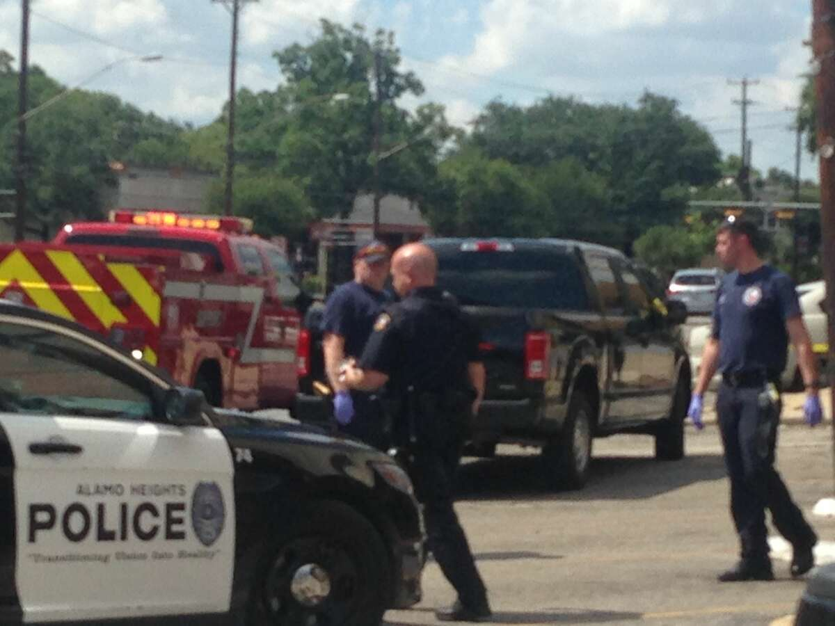Alamo Heights police work the scene of an assault in the 5100 block of Broadway Street on June 23, 2016.