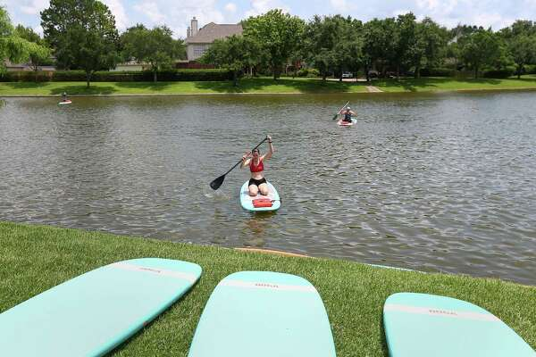 Stand-up paddleboard yoga stretching locally
