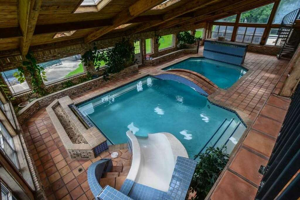 Home indoor pool with slide  Nederland home with indoor pool, water slide is a swimmer's ...
