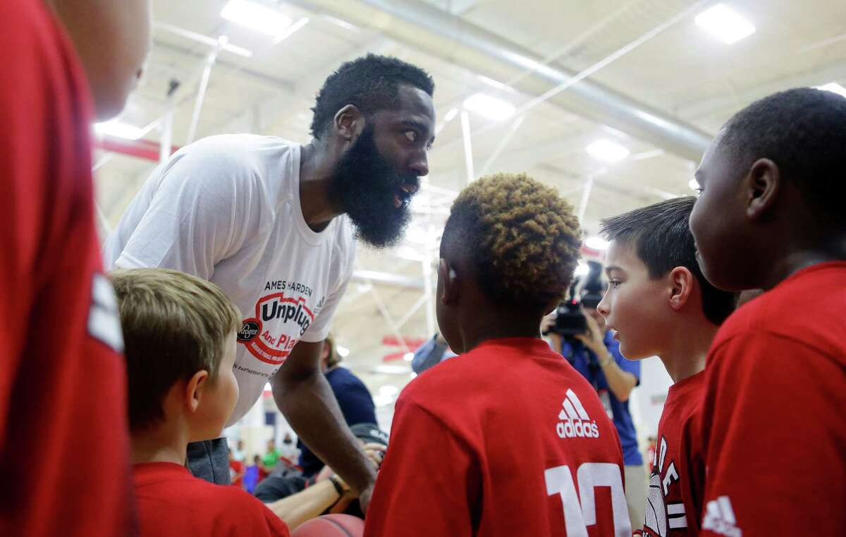 James Harden interacts with campers after team pictures at the James Harden Basketball ProCamp,Thursday, June 23, 2016, in Houston.