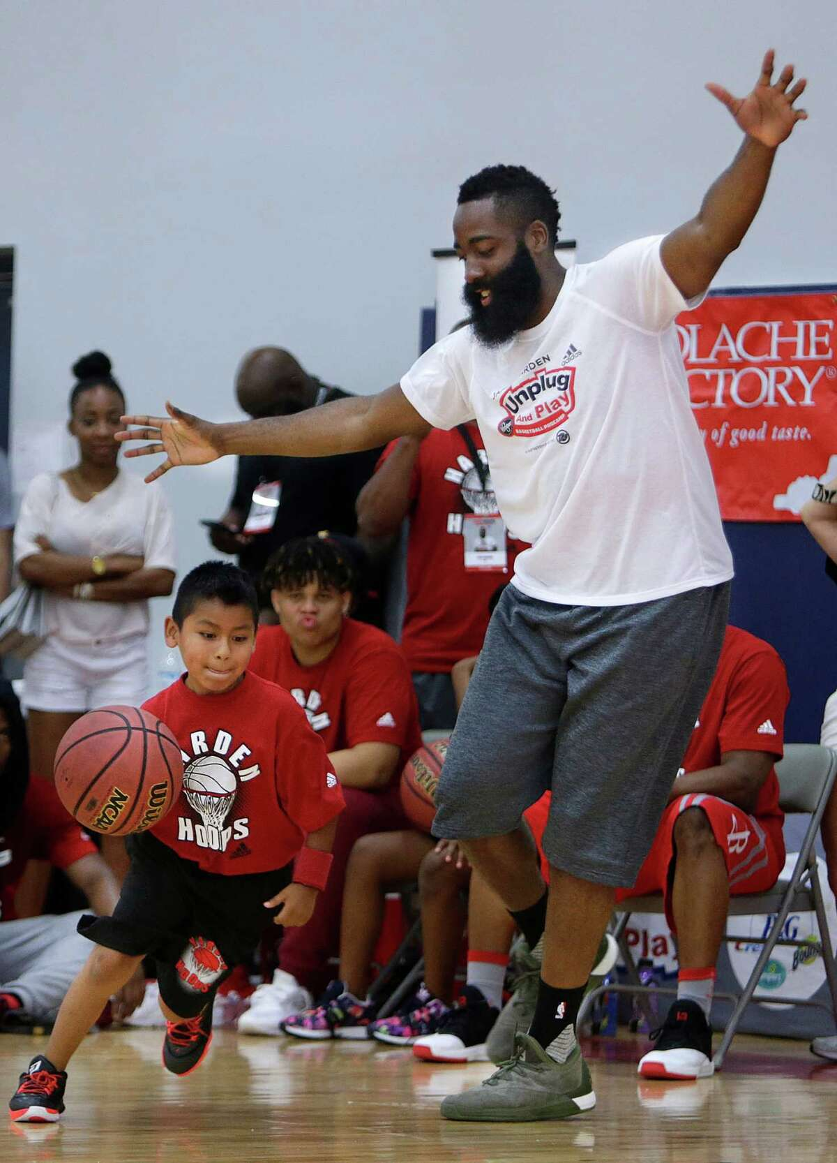 James Harden takes on a camper in a game of one on one at the James Harden Basketball ProCamp,Thursday, June 23, 2016, in Houston.