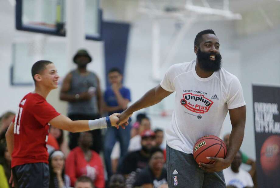 James Harden congratulates a camper during an elimination game at the James Harden Basketball ProCamp,Thursday, June 23, 2016, in Houston. Photo: Houston Chronicle / © 2016 Houston Chronicle
