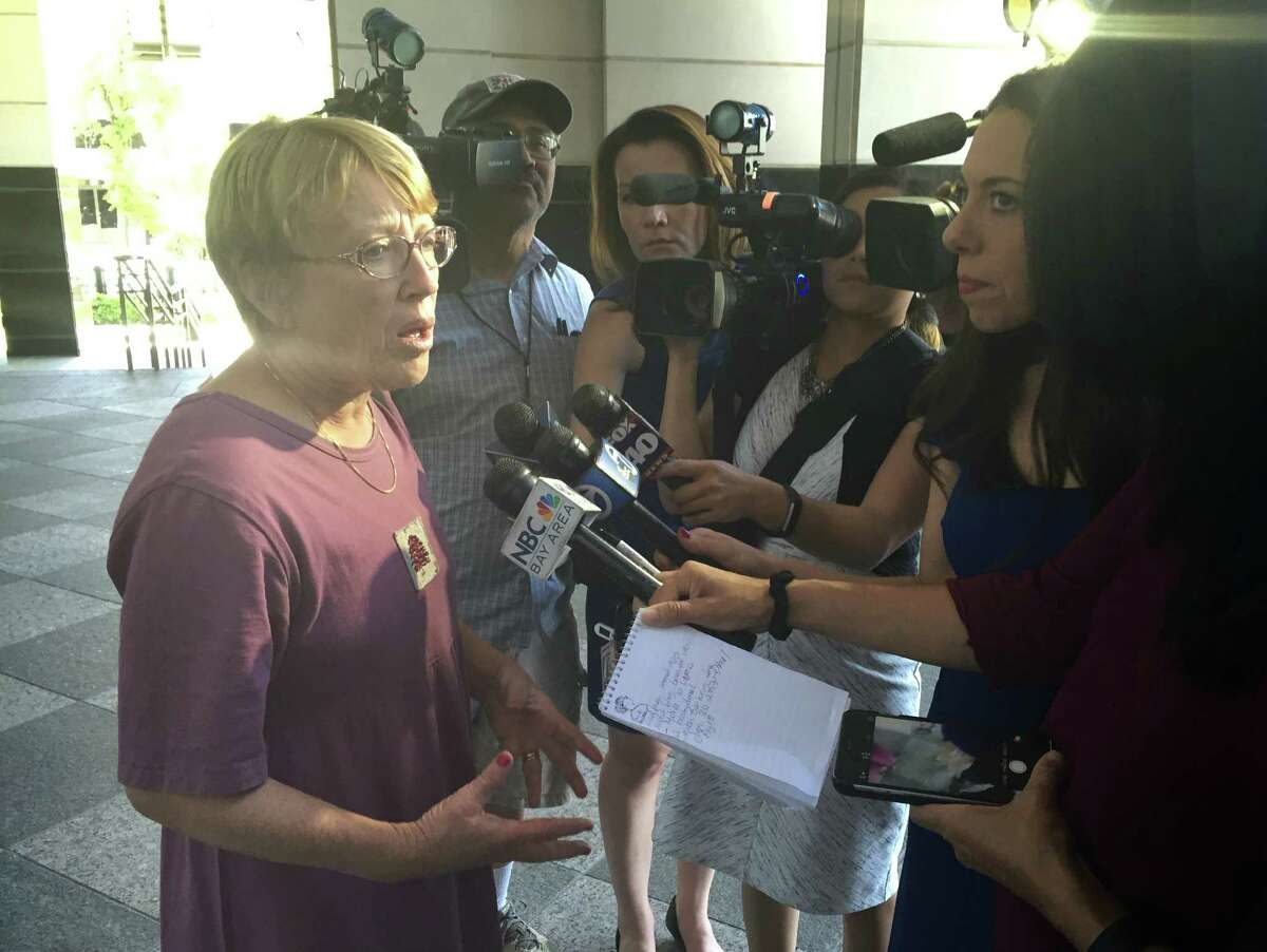 Marianne Quinn, the mother of Vallejo kidnapping victim Denise Huskins' boyfriend, speaks to reporters outside U.S. District Court in Sacramento on Thursday. Her son, Aaron Quinn, was drugged and bound when federal authorities said Matthew Muller kidnapped Huskins.