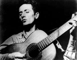 **FILE**This is an undated file photograph of folk singer Woody Guthrie, singing a song and playing his guitar.  Guthrie has written hundreds of songs, celebrating migrant workers, pacifists, and underdogs.  A summer folk music festival on the grounds of Greystone Park Psychiatric Hospital in New Jerseywill pay tribute to Guthrie, one of its most famous former patients .The August concert will also celebrate the acquisition of 300 acres of former hospital tract as parkland.  (AP Photo)