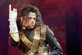 "In this Aug. 25, 1993 file photo, American pop star Michael Jackson performs during his ""Dangerous"" tour in Bangkok. (AP Photo/Jeff Widener, file)"