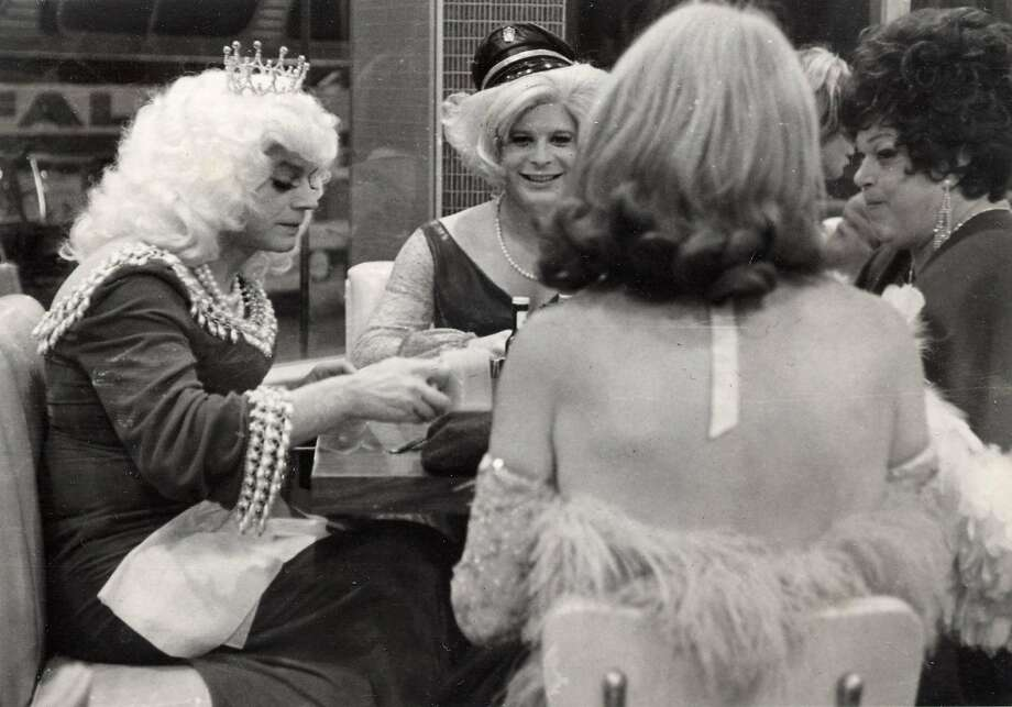 A late-night scene in Gene Compton's Cafeteria. The cafeteria was a popular destination for queer people of all kinds: hustlers, queens, hair fairies. This photo shows an Imperial Court of San Francisco event at the cafeteria. The date and names of the subjects are unknown. Photo: Henry Leleu, Courtesy The Gay, Lesbian, Bisexual, Transgender Historical Society