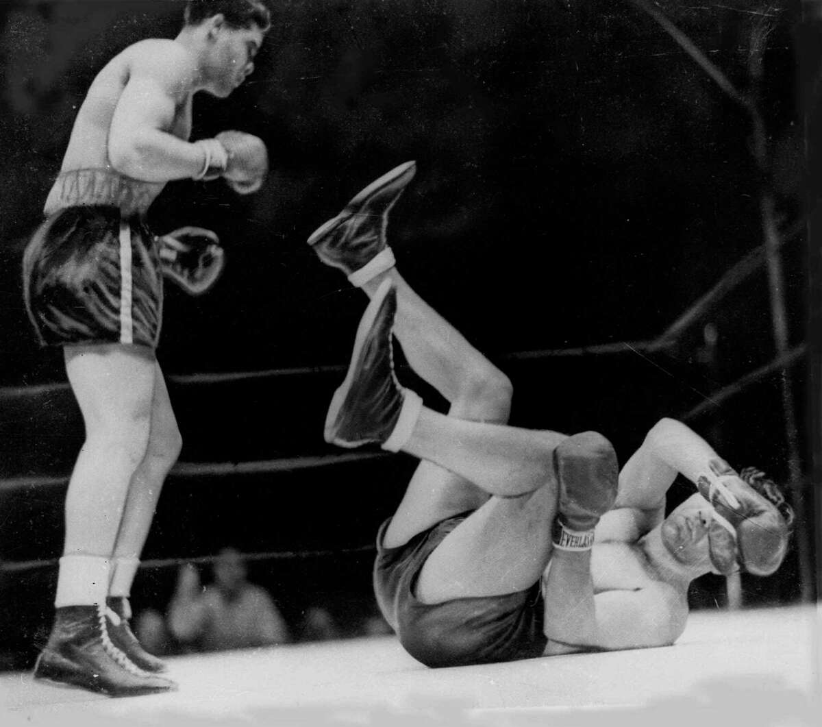 """In perhaps his greatest victory, Joe Louis clubs Max Schmeling into submission to defend the heavyweight title on June 22, 1938. A reader claims it was Louis, not Muhammad Ali, who deserves to be called """"the greatest."""""""