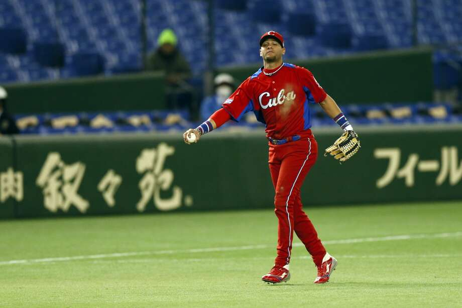 TOKYO, JAPAN - MARCH 11: Yulieski Gurriel #10 of Team Cuba reacts after misplaying the ball in the bottom of the ninth inning against Team Netherlands during Pool 1, Game 5 in the second round of the 2013 World Baseball Classic at the Tokyo Dome on March 11, 2013 in Tokyo, Japan. (Photo by Yuki Taguchi/WBCI/MLB Photos via Getty Images) Photo: Yuki Taguchi, WBCI/MLB Photos Via Getty Images)
