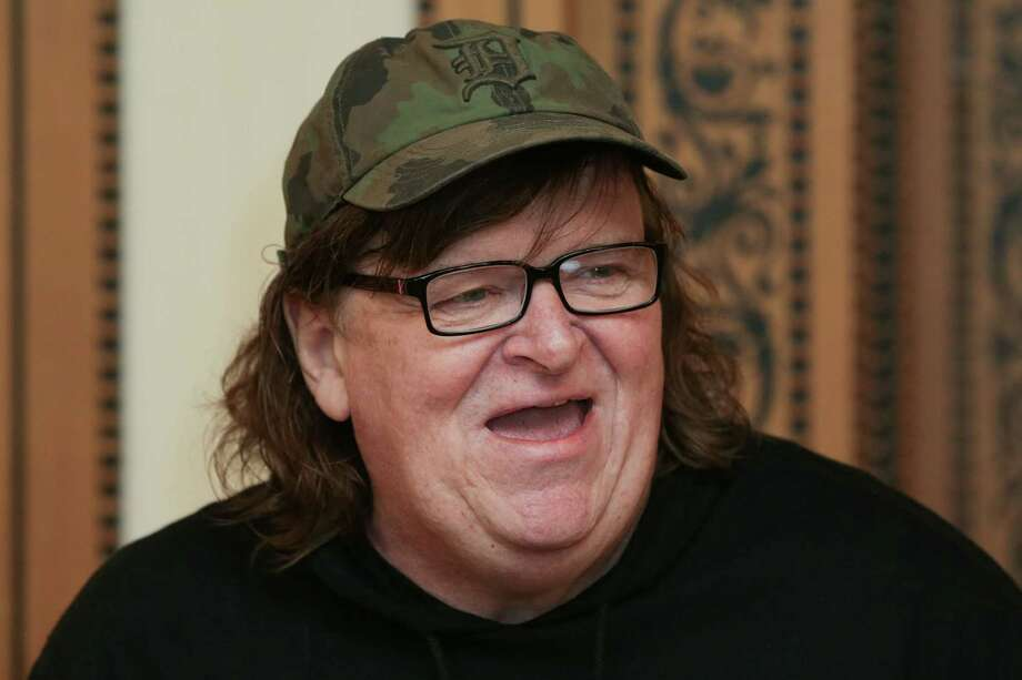 """US filmmaker Michael Moore attends a photo call for his new film """"Where To Invade Next"""" in London on June 9, 2016.  / AFP PHOTO / DANIEL LEAL-OLIVASDANIEL LEAL-OLIVAS/AFP/Getty Images Photo: DANIEL LEAL-OLIVAS, Stringer / AFP/Getty Images / AFP or licensors"""