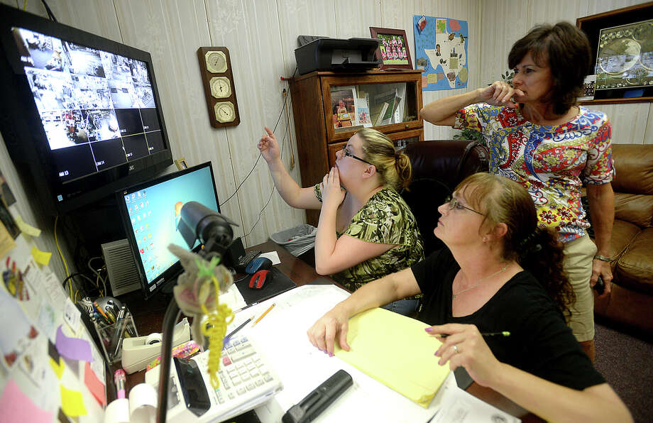 G.I. Surplus employees Jamie Hutchison and Misty Hollier (from left, sitting) and owner Donna Sanders watch the security video footage showing the robbery taking place and making note of items being stolen, after a break-in early Thursday morning at the Business. The store was one of two businesses broken into that morning. The robber had apparently been in the store the day prior, browsing but making no purchases. He allegedly first broke in between 1:30 and 2 a.m., breaking the only non-alarmed window on a front door. He returned two hours later, filling three large duffel bags with a variety of items, ranging from case of MRE's to machetes, clothing, boots, as well as WWII bayonets that were part of a display of war-era items belonging to owner Donna Sanders' father Ross Ewart. Police believe the same man may be responsible for a break-in a block away at Lucky Liquor, where several packs of cigarettes and a bottle of liquor were stolen. Photo taken Thursday, June 23, 2016 Kim Brent/The Enterprise Photo: Kim Brent / Beaumont Enterprise