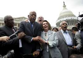 """From left, House Assistant Minority Leader James Clyburn of S.C., Rep. John Lewis, D-Ga., Rep. Joseph Crowley, D-N.Y., House Minority Leader Nancy Pelosi of Calif. and Rep. Charles Rangel, D-N.Y., sing """"We Shall Overcome"""" on Capitol Hill in Washington, Thursday, June 23, 2016, after House Democrats ended their sit-in protest. (AP Photo/Carolyn Kaster)"""