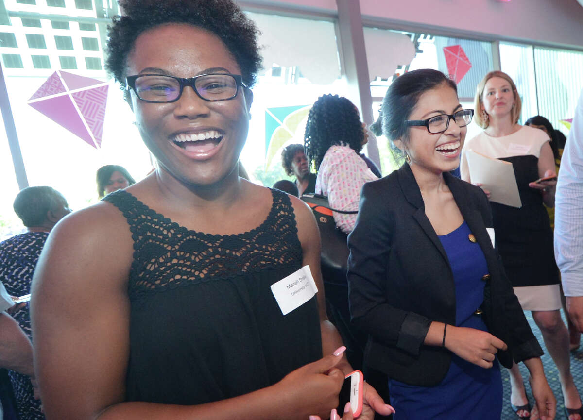 Mariah Smalls and Genesis Hernandez are all smiles as they are recipeints of a 2016 Norwalk Housing Foundation Undergraduate Scholarships, during the 18th Annual Scholarship Awards Ceremony at Stepping Stones Museum for Children on Wednesday June 22, 2016 in Norwalk Conn.