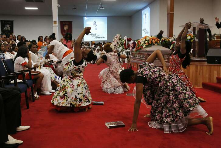 Members of the Ascension Dance Company perform a Praise Dance at the memorial service for Reggina Jefferies at Acts Full Gospel Church June 23, 2016 in Oakland, Calif. Jefferies was killed while attending a memorial service for two young men who had drowned over memorial day weekend.