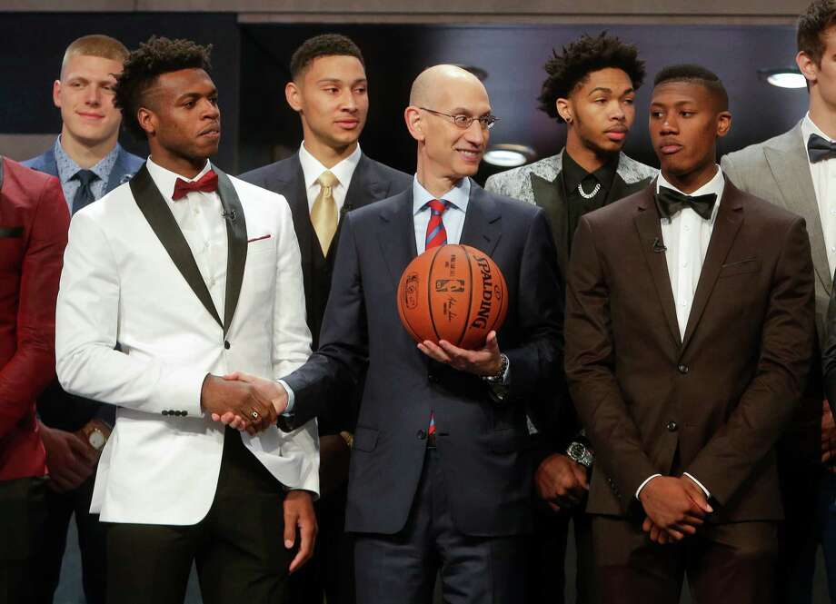 NBA Commissioner Adam Silver, center, poses for photos with prospective NBA draft picks Buddy Hield, left, Kris Dunn, right, Ben Simmons, third from left, and Brandon Ingram, second from right, before the start of the NBA basketball draft, Thursday, June 23, 2016, in New York. (AP Photo/Frank Franklin II) Photo: Frank Franklin II, Associated Press / AP