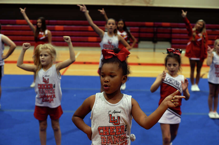 Campers practice cheering during the final day of Lamar University's spirit team camp on Thursday. The combined was a joint effort from the cheerleading and dance teams teaching both to participants.  Photo taken Thursday 6/23/16 Ryan Pelham/The Enterprise Photo: Ryan Pelham / ©2016 The Beaumont Enterprise/Ryan Pelham