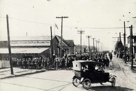 Soldiers marching near Camp Logan, the area now occupied by Memorial Park, in 1917.