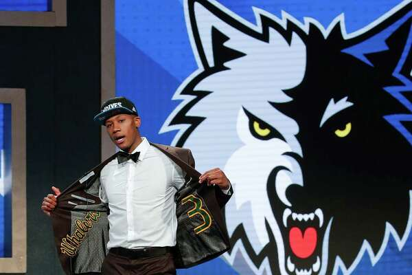 Kris Dunn reacts as he steps up on stage after being selected fifth overall by the Minnesota Timberwolves during the NBA basketball draft, Thursday, June 23, 2016, in New York. (AP Photo/Frank Franklin II)