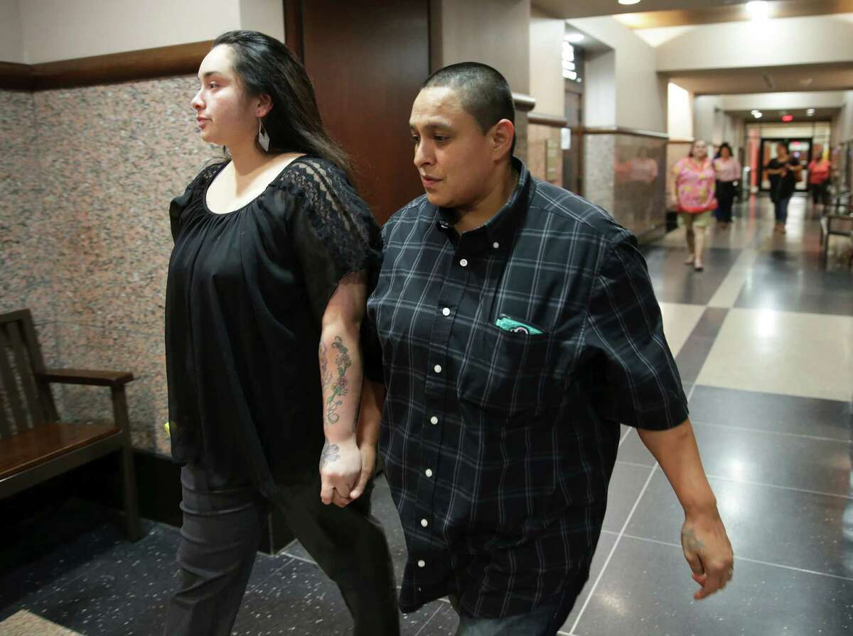Carlotta Balleza (left),natural mother of the the victim, walks away from the courtroom with Laura Huereca during the punishment phase in the trial of Crystal Williams, stepmother of Josiah Williams, on June 23, 2016.
