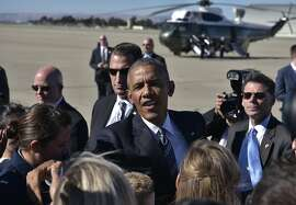 US President Barack Obama greets well-wishers upon arrival at Moffett Federal Airfield, in Mountain View, California on June 23, 2016. / AFP PHOTO / MANDEL NGANMANDEL NGAN/AFP/Getty Images
