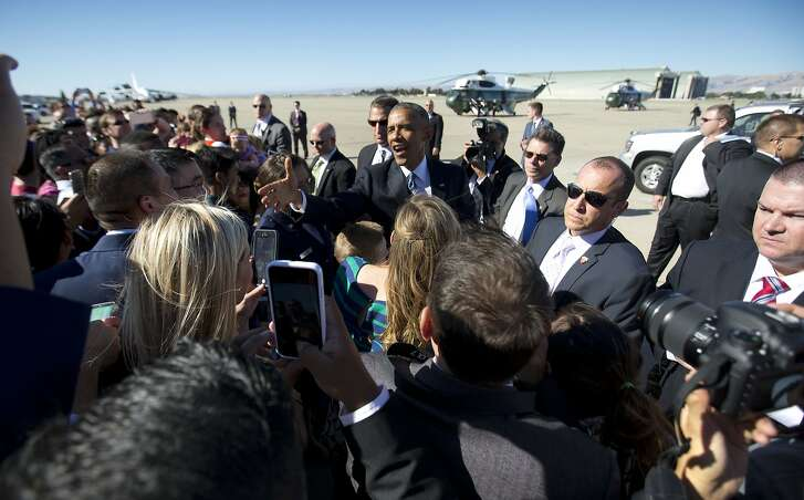 President Barack Obama, center, greets guest on the tarmac upon his arrival on Air Force One at Moffett Federal Airfield in Mountain View, Calif., Thursday, June 23, 2016. Obama is traveled to the San Francisco-Bay Area today and is attending a Global Entrepreneur Summit at Stanford University tomorrow. (AP Photo/Pablo Martinez Monsivais)