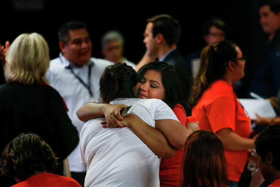 In Houston, just after the Supreme Court's decision was announced, Myrna Orozco, right, comforts an emotional Alondra Chavez. Both are undocumented immigrants. Photo: Michael Ciaglo, Staff / © 2016  Houston Chronicle