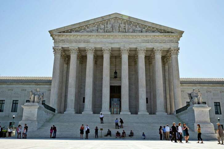 The Supreme Court is seen in Washington, Monday, June 20, 2016, as the court announced several decisions. (AP Photo/Alex Brandon)
