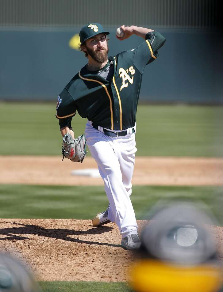 Dillon Overton, 72 throws during a an intra-squad game at the Oakland Athletics spring training workouts on Monday February 29, 2016, in Mesa, Arizona.