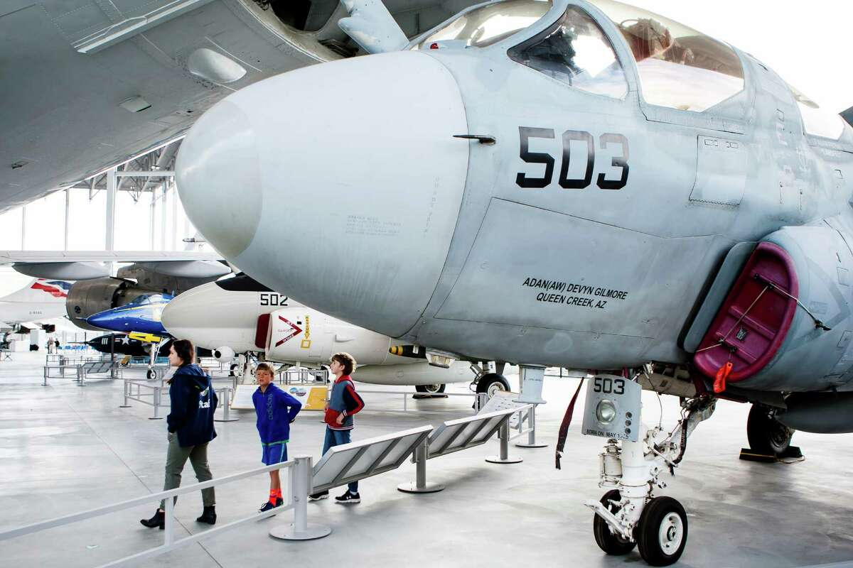 Museum goers walk by a EA-6B Prowler before the opening of the Aviation Pavilion at The Museum of Flight in Tukwila on June 23, 2016. The Prowler was initially employed by the U.S. Navy in 1972.