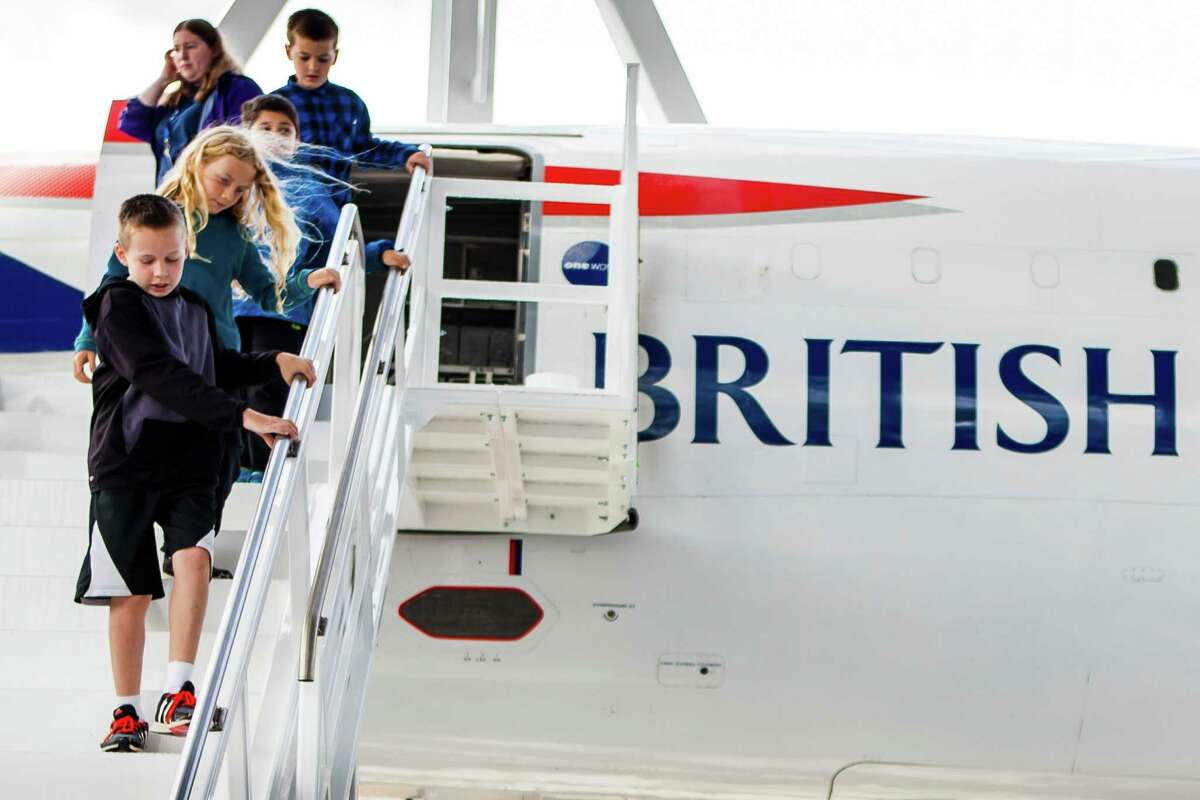Children make their way down the stairs of the Concorde, the first commercial airliner to fly faster than the speed of sound.