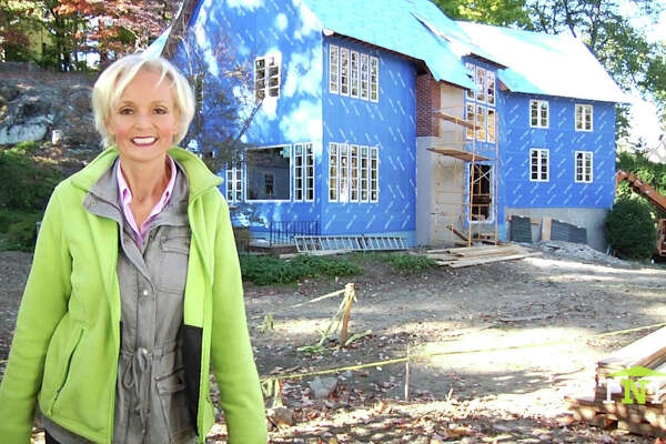 Sabine Schoenberg, founder of This New House, stands in front of her latest project, the Greenwich Blue House on Old Church Road.