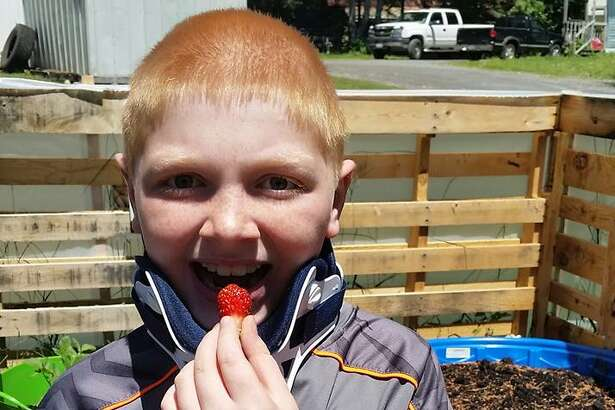 Zane Peterson  at home in his garden Thursday. (Provided by Joann Lorman-Woodruff)