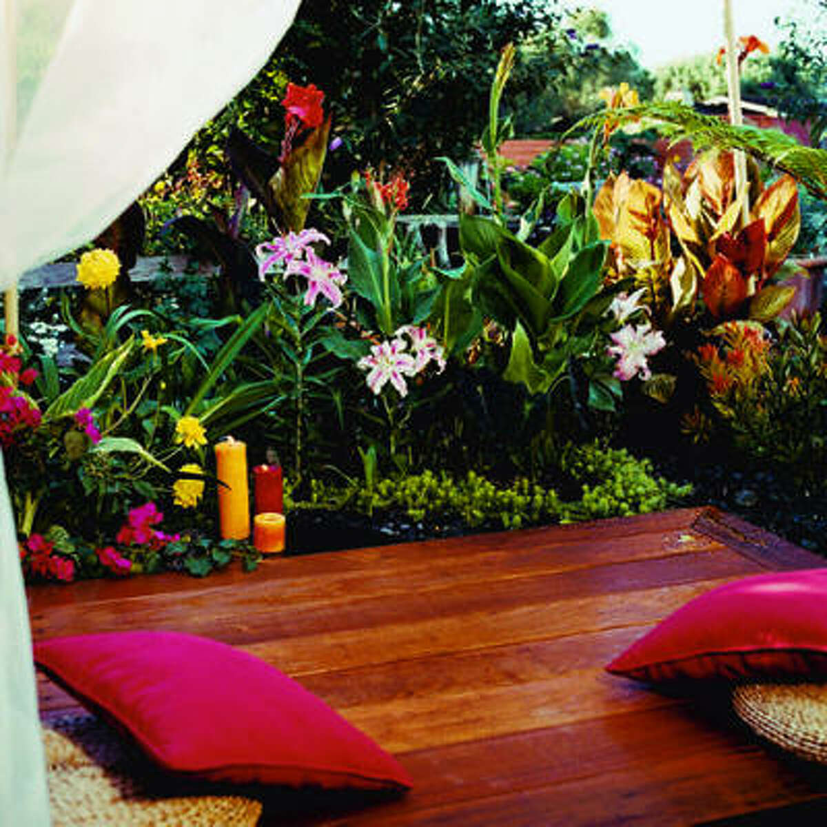 Billowy Bali retreat Sit on this compact deck, pull the netting around you, and you'll feel almost like you're floating in a cloud above a jungle of exotic flowers. Get the how-to
