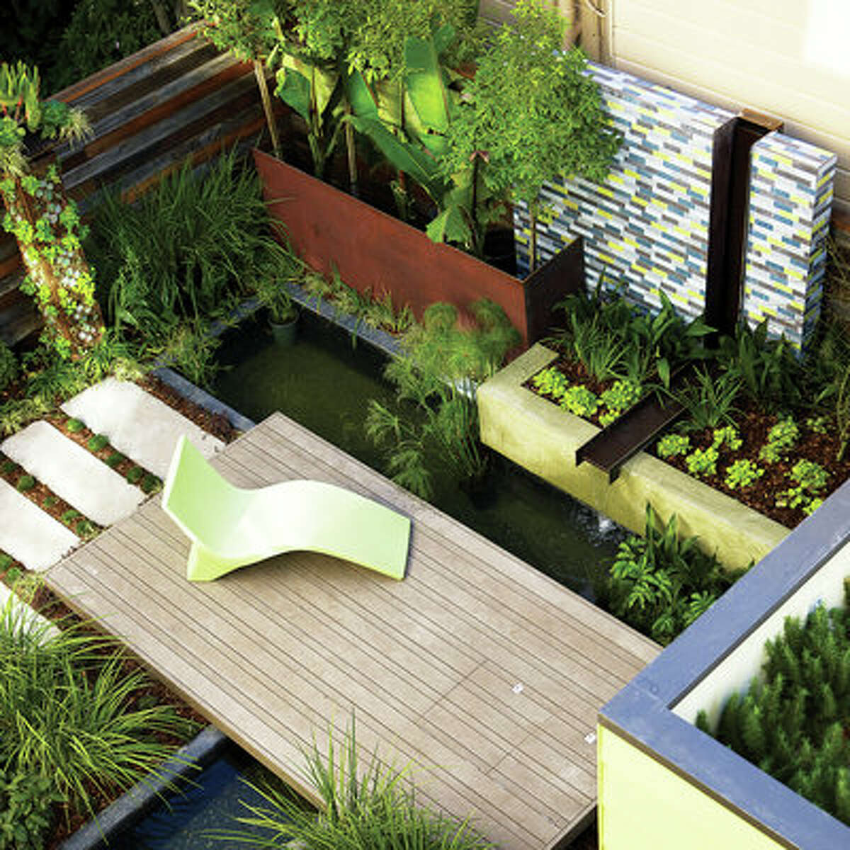 Urban retreat A deck surrounded by a fountain and pond creates an island of calm in the middle of San Francisco. The water features create an urban habitat that attracts birds and can sustain fish and turtles. Take a video tour of this eco-minded home