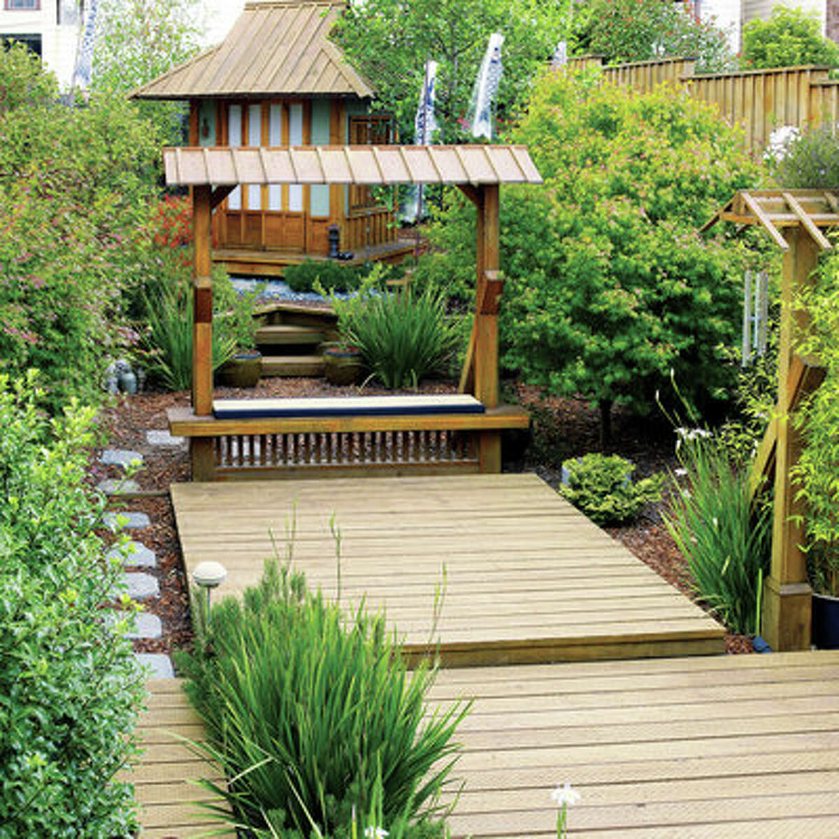 New dimensions David Polifko transformed his backyard with three decks of different sizes, at three different levels. A deck also wraps around an 8-feet-square teahouse, angled to fit a tight corner. See more pictures of his decks and garden