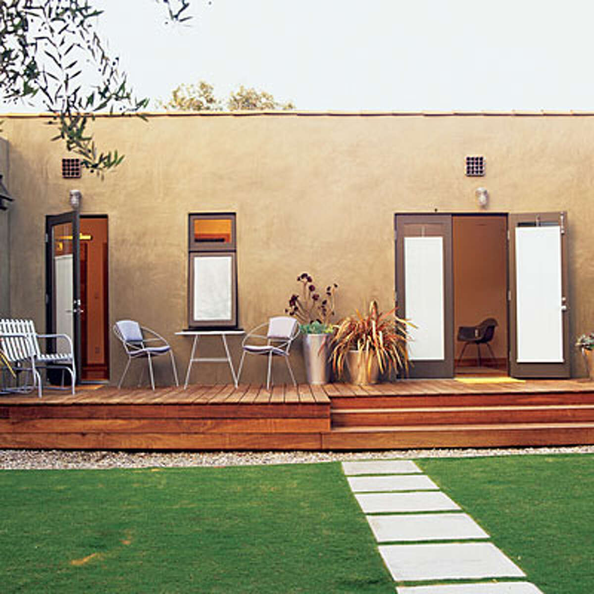 Small-home solution A new deck off the back bedrooms helped design team John Jennings and Sasha Tarnopolsky make the most of their 1,100-square-foot home. The deck, made from Ipe wood, acts as extensions of the living areas, a private outdoor retreat, and a graceful, 3-step transition to the garden. See the backyard before