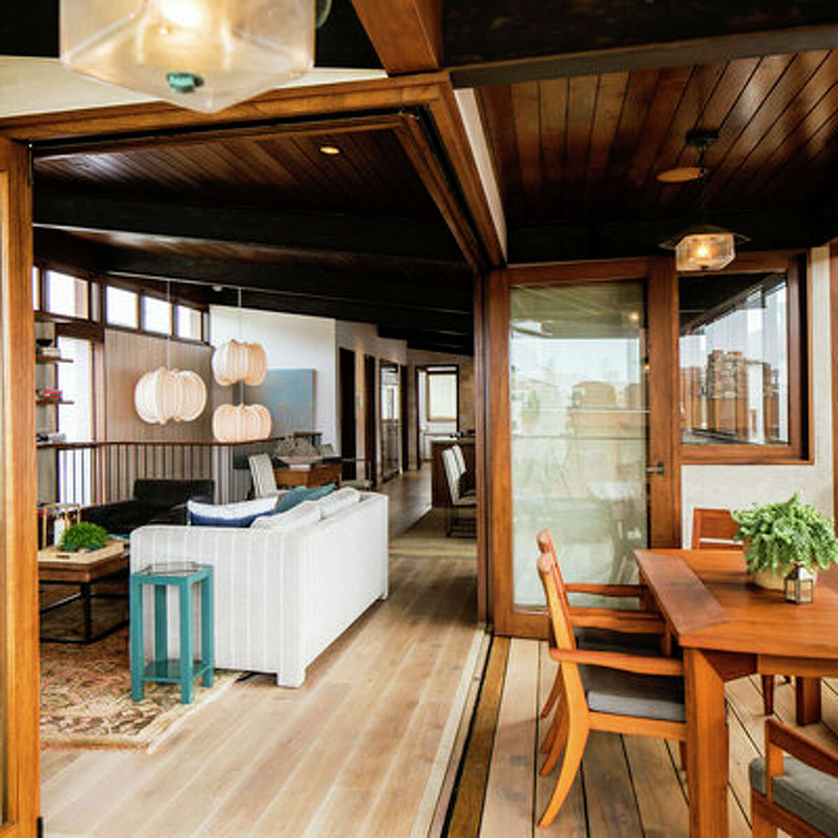 Treat the outside like the inside With the doors to the deck open and folded back against the exterior walls, it feels like the living room and deck are one. The homeowner chose outdoor furniture that completely meshes with what's inside.