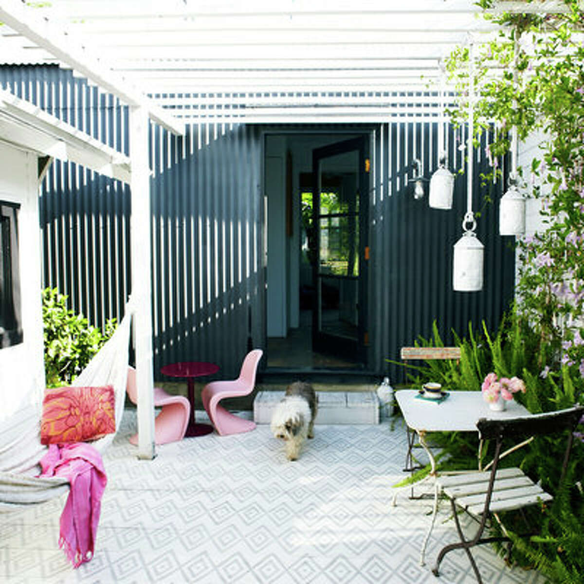 Subtle attraction Gray is the perfect color for adding subtle detail, like this painted deck. Imagine it with a color-fun, but with an entirely different feel. Soft gray plays against the pink for a restful, feminine vibe.