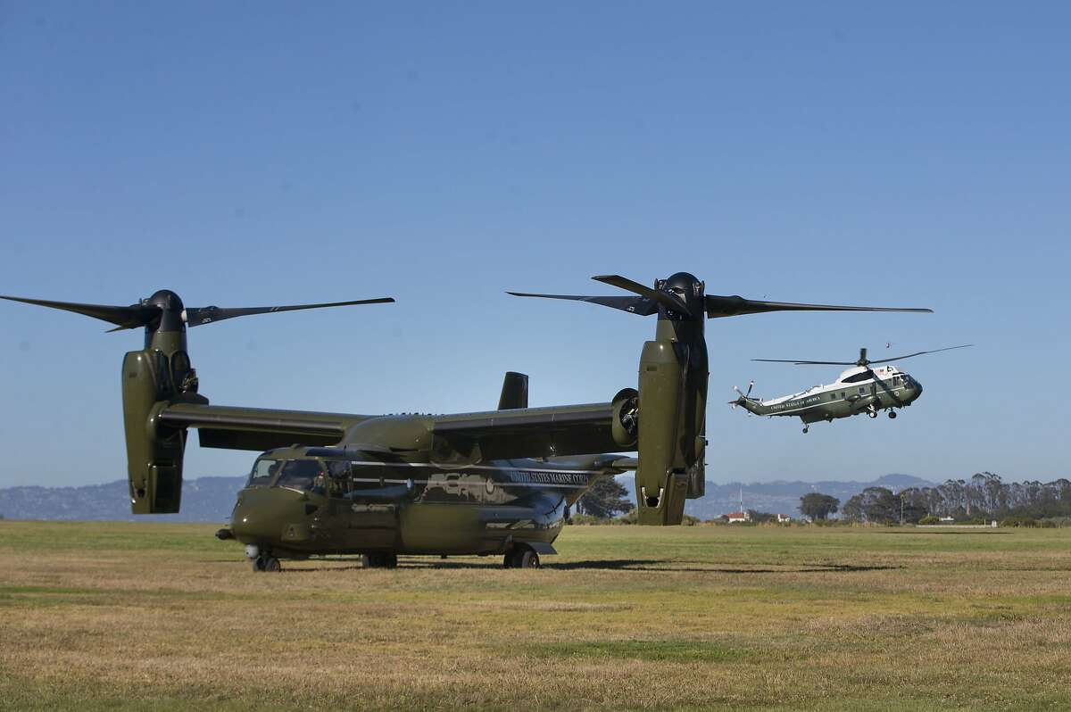 Marine One helicopter, right, with President Barack Obama aboard, makes its approach on landing at the Crissy Field in San Francisco, Thursday, June 23, 2016. Obama traveled to the San Francisco-Bay Area today and is attending a Global Entrepreneur Summit at Stanford University.
