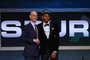 NEW YORK, NY - JUNE 23:  Dejounte Murray shakes hands with Commissioner Adam Silver after being drafted 29th overall by the San Antonio Spurs in the first round of the 2016 NBA Draft at the Barclays Center on June 23, 2016 in the Brooklyn borough of New York City. NOTE TO USER: User expressly acknowledges and agrees that, by downloading and or using this photograph, User is consenting to the terms and conditions of the Getty Images License Agreement.  (Photo by Mike Stobe/Getty Images)