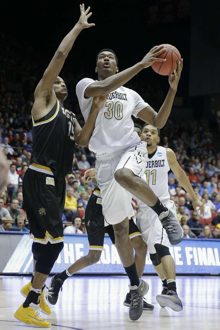 Vanderbilt Damian Jones (30) shoots against Wichita State Anton Grady (15) in the first half of a First Four game of the NCAA college basketball tournament, Tuesday, March 15, 2016, in Dayton, Ohio. (AP Photo/John Minchillo)